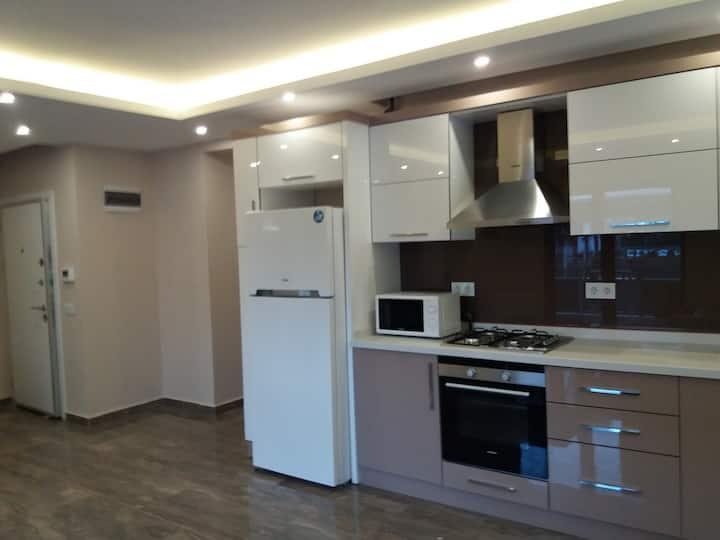 Новая квартира 1+1 в Коньяалты /Гюрсу 100м до моря