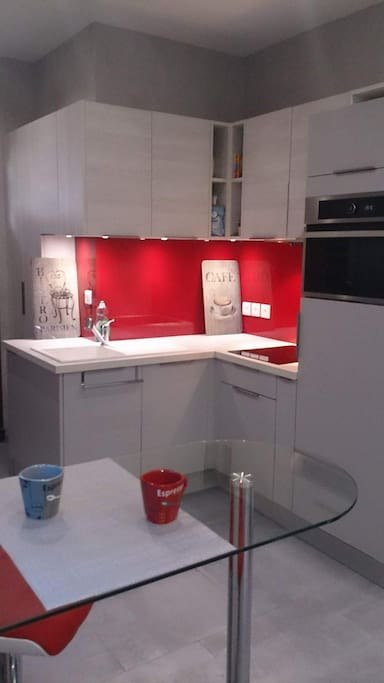 Зона кухни в студии