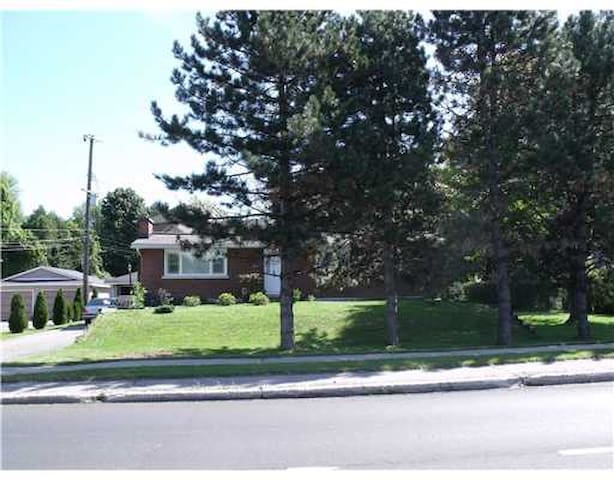 Street view of property - large landscaped front and backyard with patio lot.