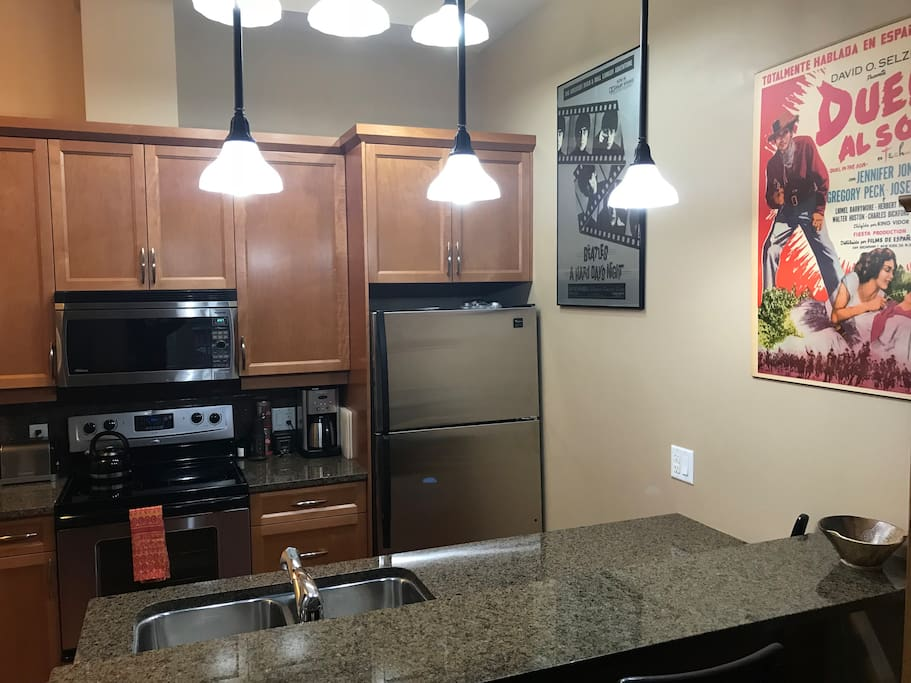Fully stocked kitchen with eating bar