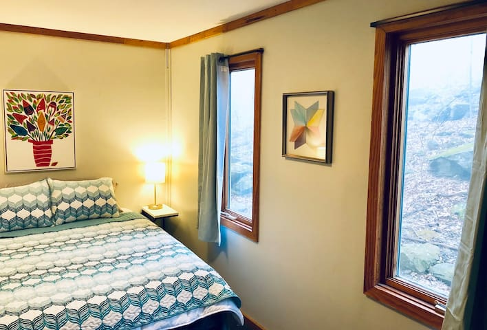 En suite bedroom 1, a spacious bedroom suite located on the main level, front of the house.