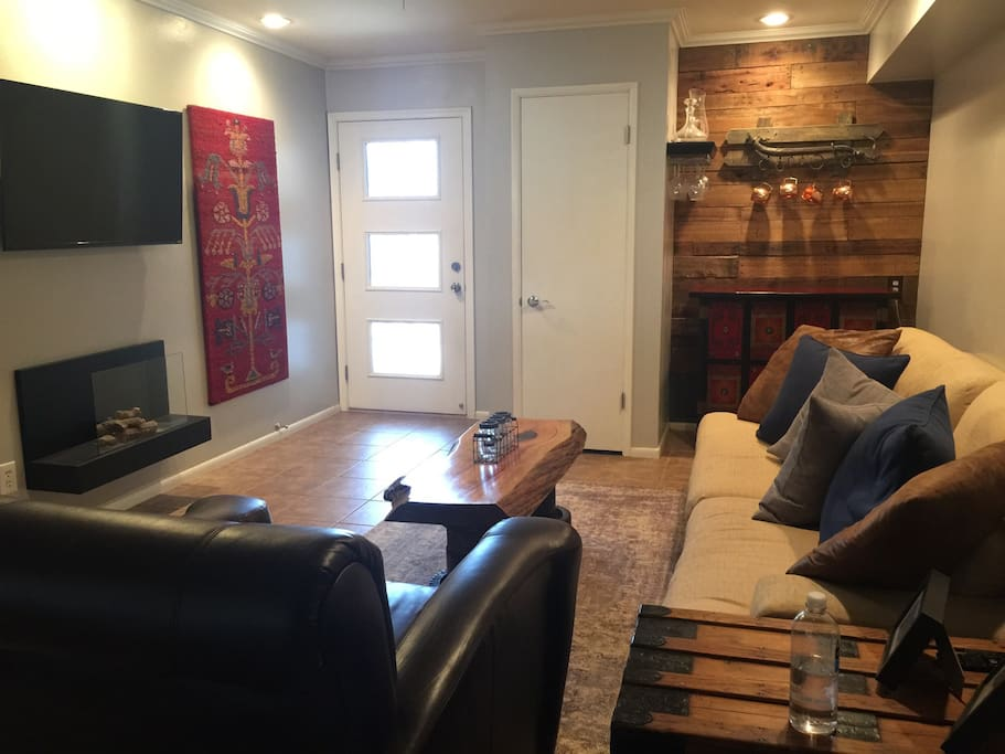 Spacious living room and front entrance. The fireplace has been removed for safety reasons.