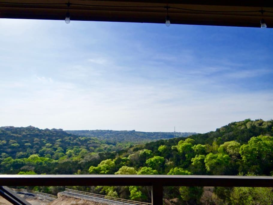 Deck with stunning Texas Hill Country views. Looking west for gorgeous sunsets. Relax with A glass of wine, Blue-tooth Bose Speakers, BBQ Grill and a Mini Fridge.