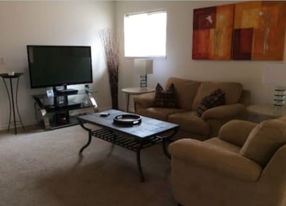 comfortable open concept living room with 50 inch tv.