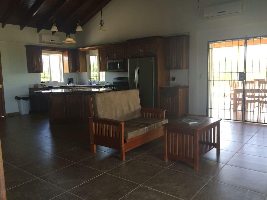 Livingroom, kitchen, doors go onto large deck