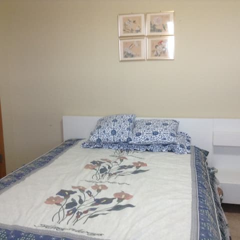 A private room & bath, indoor parking, in w suburb