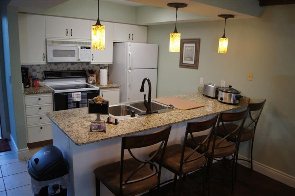 Kitchen With Granite Counters and Breakfast Bar