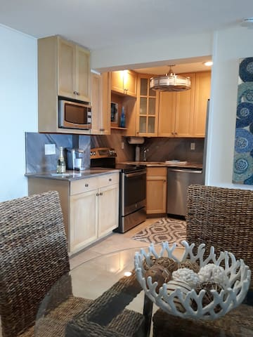 Fully equipped kitchen. Tiled flooring throughout.