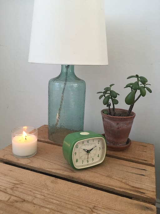 Soy candle for evening ambiance and alarm clock to make sure your evening doesn't delay your morning!