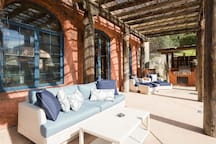 Outdoor cozy furniture for lounging with outdoor kitchen