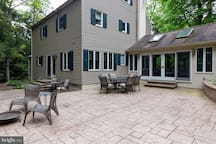Huge, stamped concrete patio with fire pit and outdoor seating.