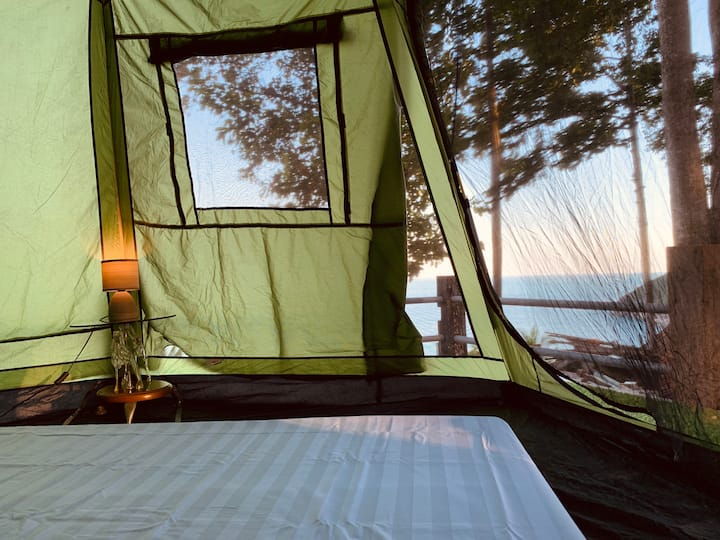 Hilltop tent in the jungle with seaview (sunrise)