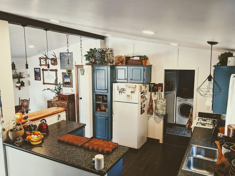Newly remodeled kitchen. Open counter space, custom juniper bar top, fully stocked with all appliances (except no microwave), dishwasher.