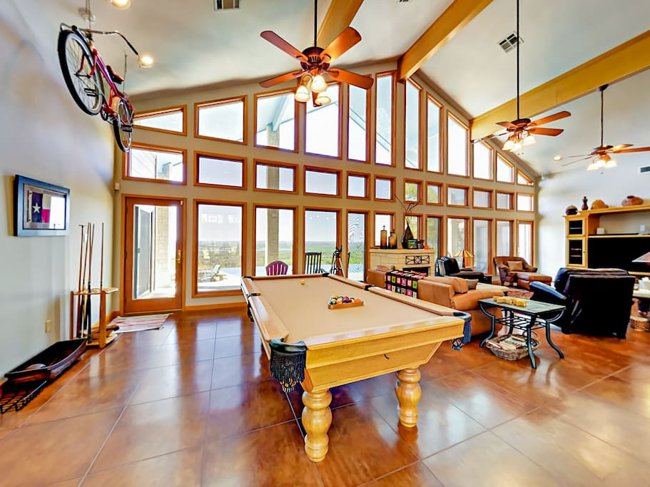 The living room includes a gorgeous, solid wood billiard table.