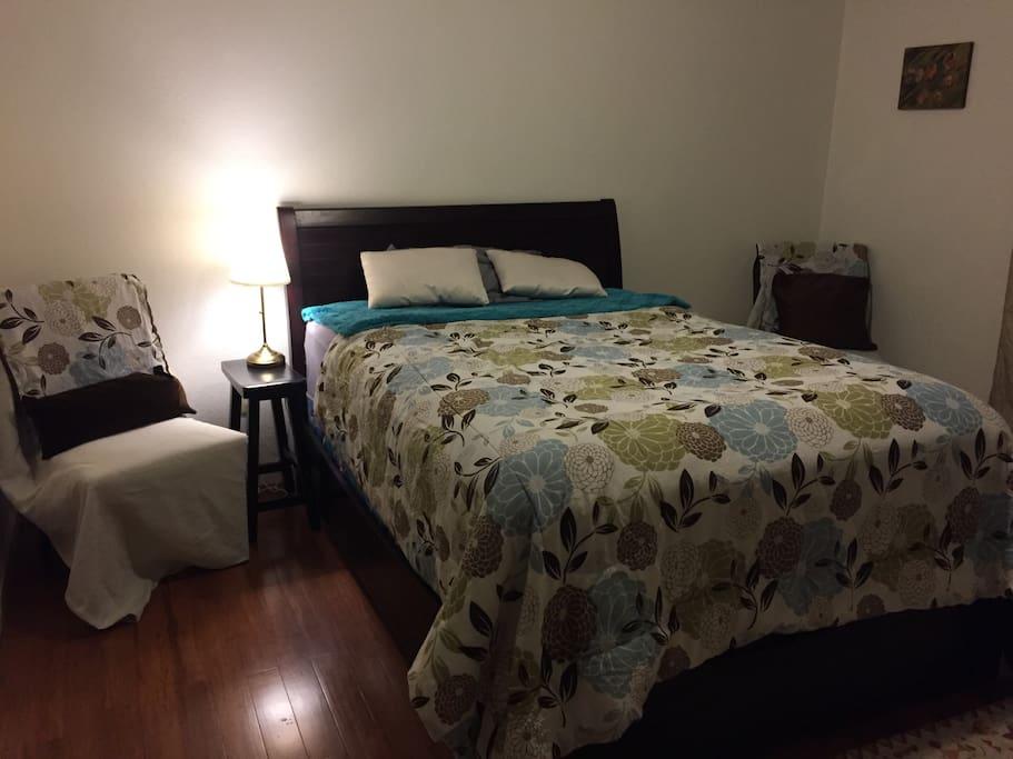 Comfortable, large room with hardwood floor..