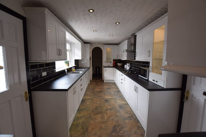 Fitted kitchen with utility. Gas hob, electric oven, microwave and plenty of cupboard space.