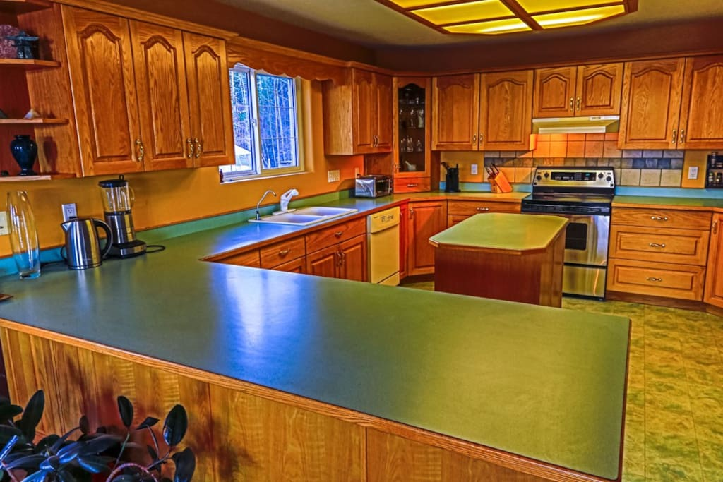 Kitchen with all appliances, dishes and cutlery
