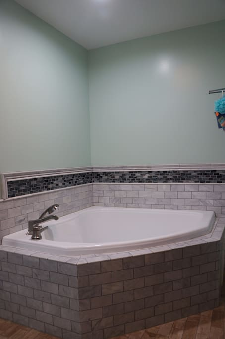 Master Bath (large corner tub with a separate shower).