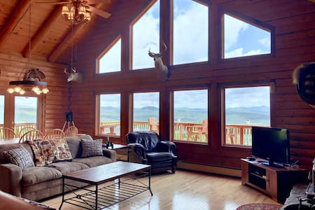 231SIM: INCREDIBLE VIEWS from this log cabin with large deck, huge yard, fire pit, hot tub, minutes from skiing, Santa's Village, and all that Northern New England has to offer! PROFESSIONALLY CLEANED!