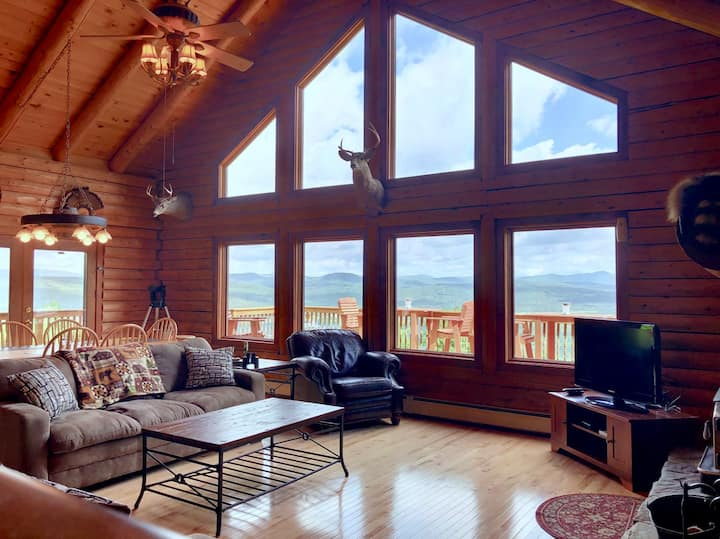 231SIM: INCREDIBLE VIEWS from this log cabin with large deck, huge yard, fire pit, hot tub, minutes from skiing, Santa's Village, and all that Northern New England has to offer! PROFESSIONALLY MANAGED!