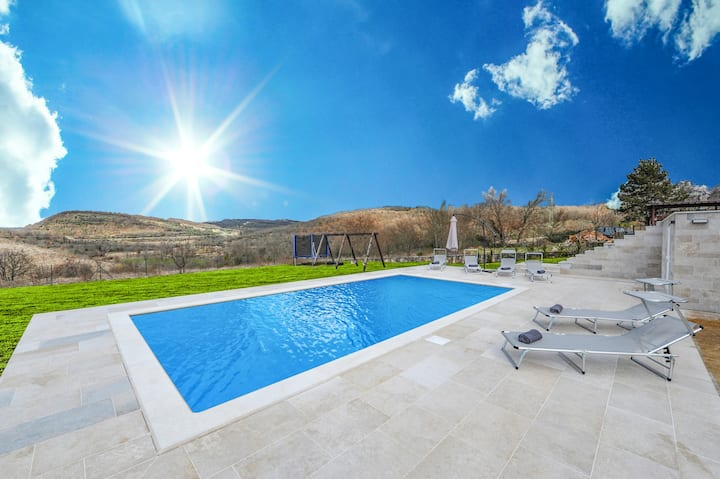 Villa with heated pool and playground