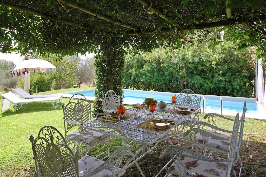 Dining table outside and pool