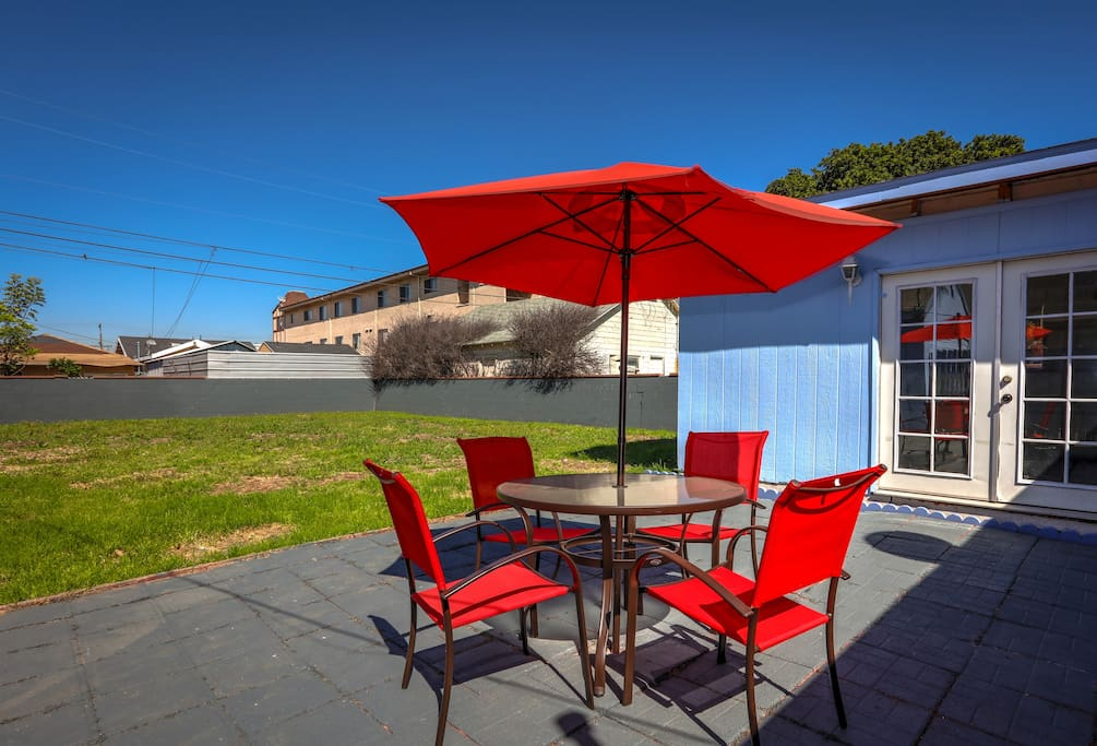 A 4-person patio table with umbrella offers a little shade and a place to sit