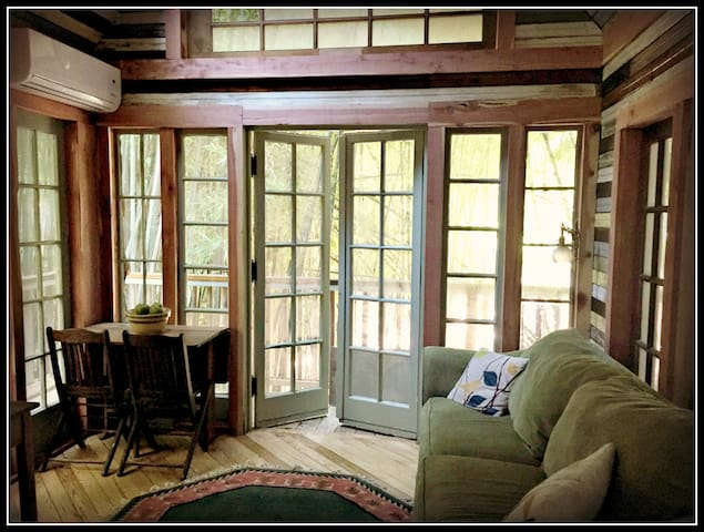 Imagine soaking this up. You could be in Bali, Hawaii, Laos. Vintage Victorian French doors, antiques, cedar trim, 1905 heart of pine church flooring, heat/air, a sleeping loft, and views of alpacas, llamas, and the bamboo forest.  This is your peace—but just minutes from great food and shopping and wine.