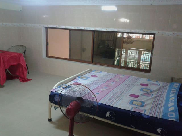 Nice bedroom  central - Good deal for long stay.