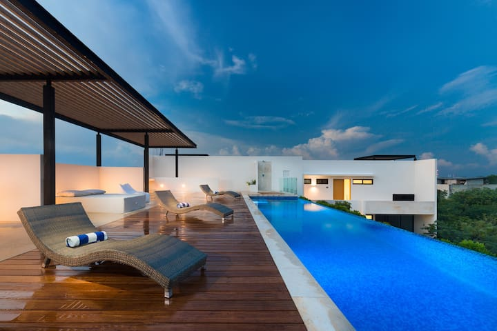Relax on the shared rooftop infinity pool