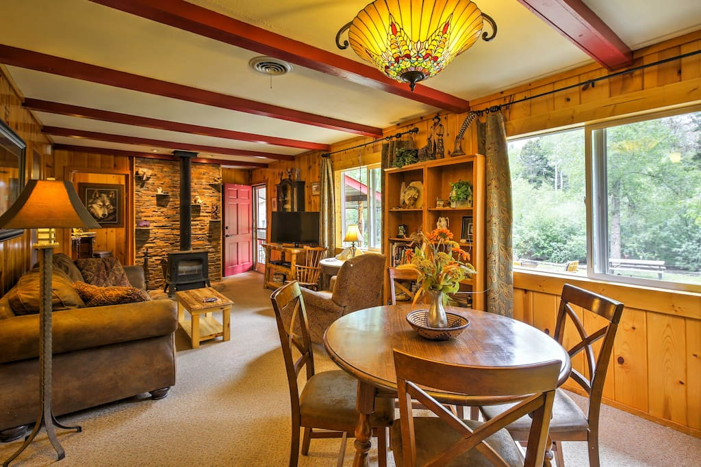 The cozy cabin features rustic decor and comfortable furnishings.