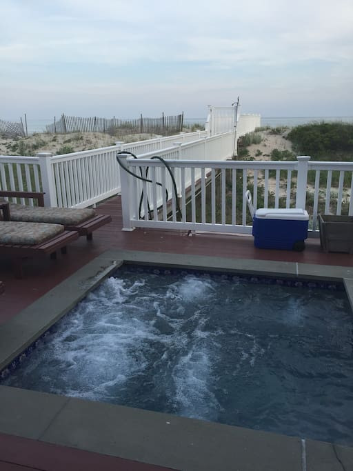 Jacuzzi and walkway to beach and ocean.