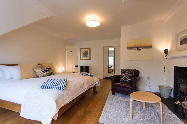 Main Bedroom, Superking (6ft wide) bed, wood-burning stove and large walk-in cupboard