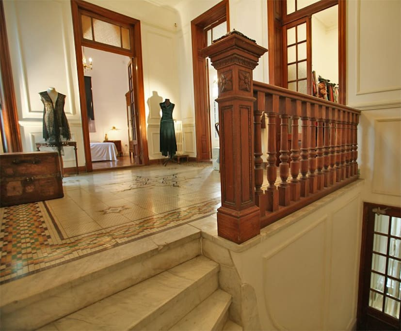 Marble staircase leading up to the hallway