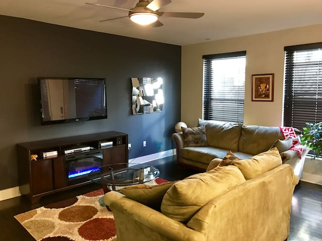 "Living Room w/ Fireplace and 55"" TV"