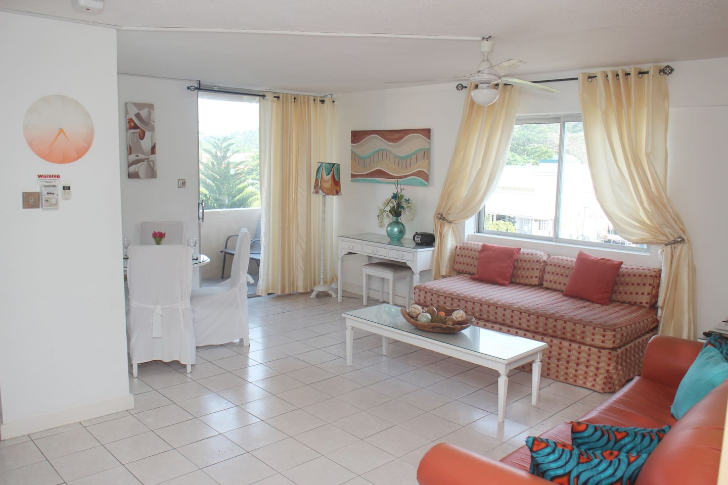 spacious lounge with cable TV and wi-fi leads onto a balcony with views of the sea to your left and mountains to your right..
