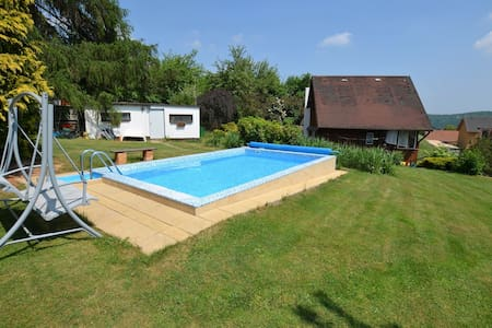 Beautiful holiday home with pool in a well-kept garden, only 35 km from Prague