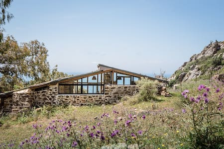 Charming mountain hideaway with  sea views.