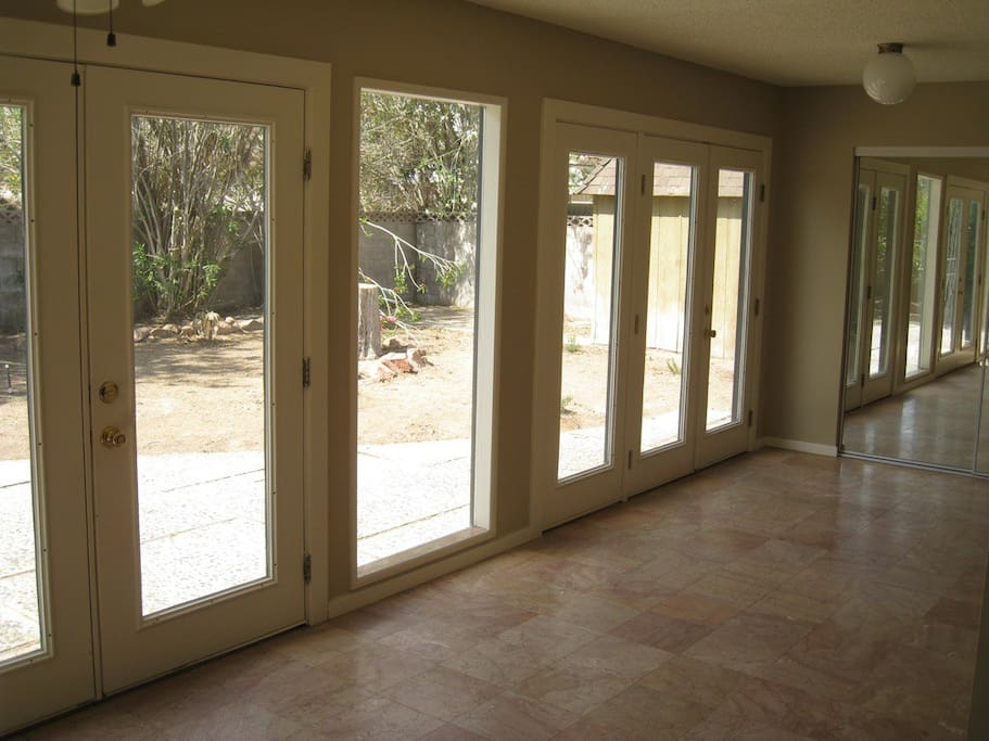 French glass doors in the back of the house over looking the back yard