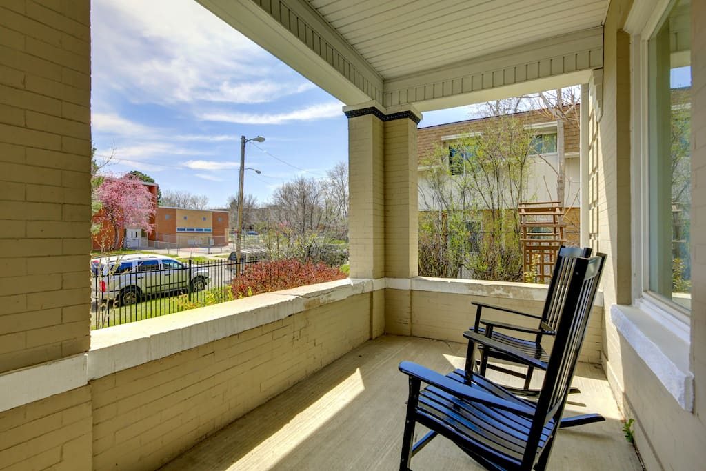 Spacious front porch with comfortable rocking chairs to enjoy lovely outdoor weather