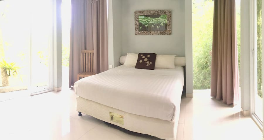Sunny Garden View Private Bedroom with attached bathroom located on second floor of our villa