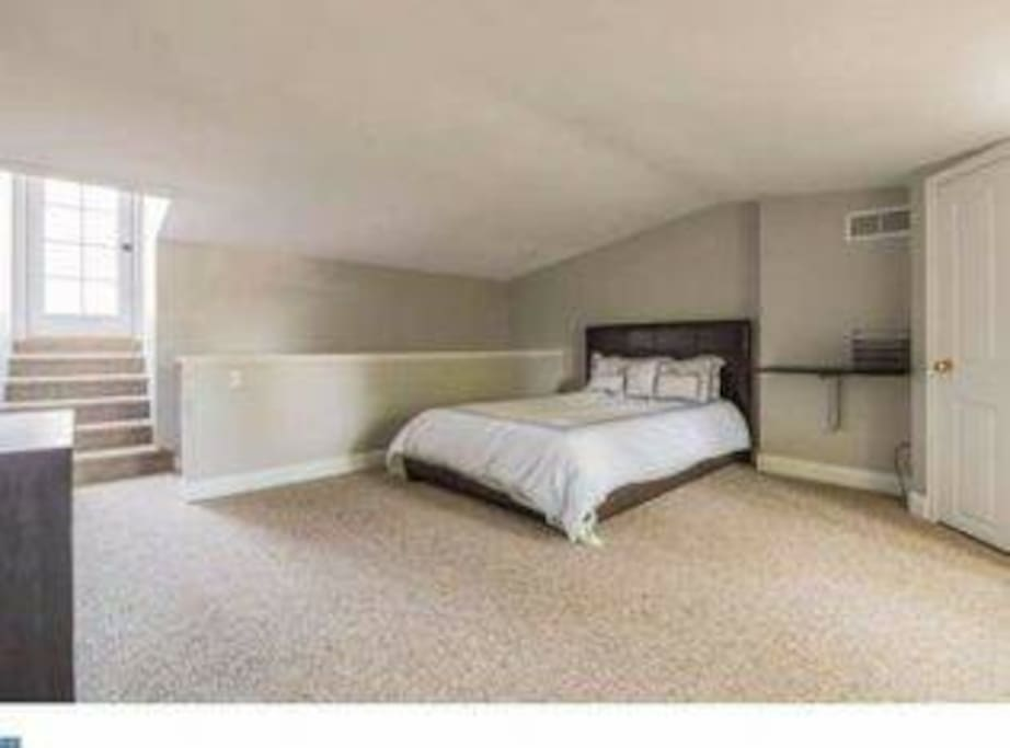 Large, private bedroom on 3rd floor with queen bed & private access to rooftop deck
