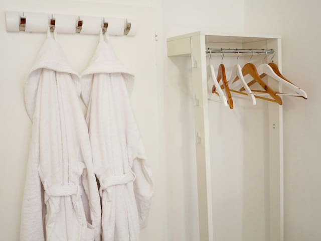 Bath robes to go to and from the bathroom just outside the room. Read in full the room description.