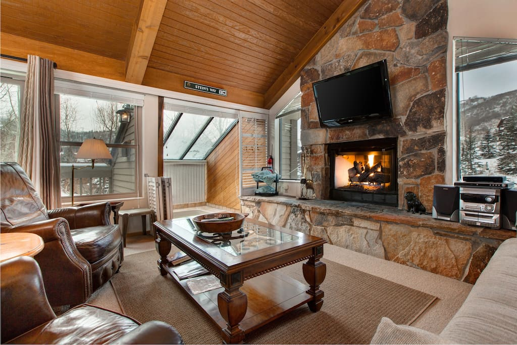 The hot tub is to the left of the TV and fireplace!