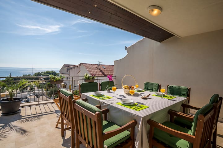 Top floor spacious terrace with garden table and chairs.