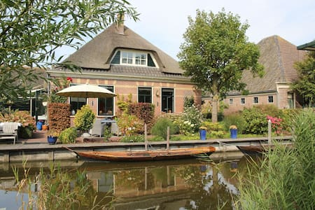 Spacious family house on islet with large garden, close to beach and Amsterdam