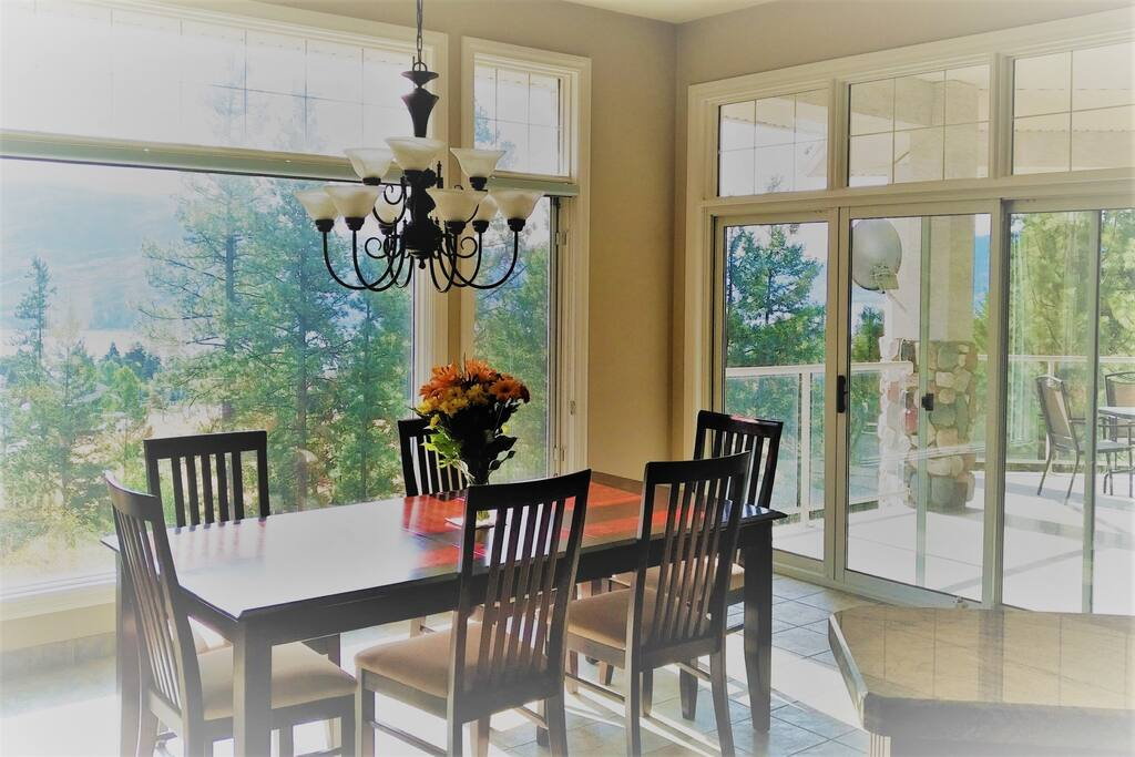 Enjoy dining inside with a view of Okanagan Lake.