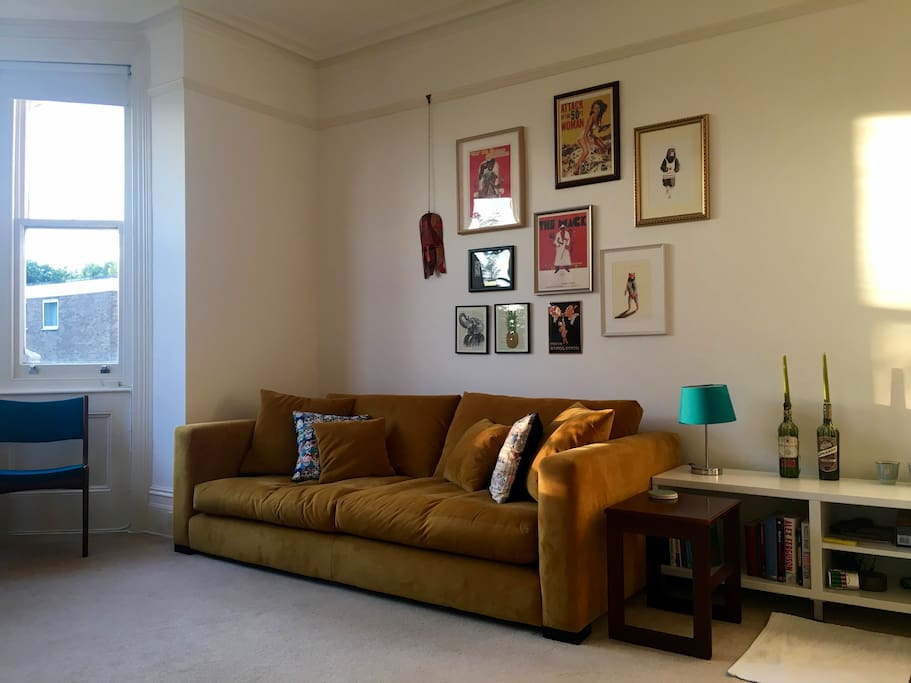 The living room gets lots of natural light and is a lovely place to spend time reading or watching TV.