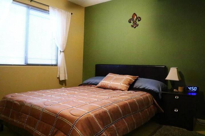 2nd bedroom, Queen Mattress medium firm, large closet, tile floors with rug, alarm clock