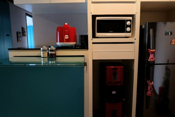 Amenities (rice cooker, microwave, bread toaster, water dispenser, fridge)
